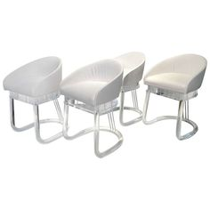 Set of four Lion in Frost Acrylic Dining Chairs   From a unique collection of antique and modern dining room chairs at http://www.1stdibs.com/furniture/seating/dining-room-chairs/