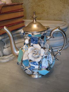 Mosaic hinged pewter tea pot in blues mosaic art. A tarnished, pealing, dented pot could be re-vitalized like this!