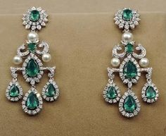 Checkout Tanishq gorgeous diamond emerald and south sea pearl chandelier earrings Diamond Earrings Indian, Diamond Chandelier Earrings, Diamond Drop Earrings, Emerald Earrings, Emerald Jewelry, Diamond Studs, Diamond Jewelry, Gold Jewelry, Pearl Chandelier