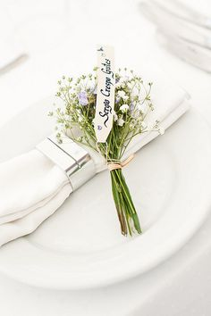 Lovely name card idea. Would go lovely with the cows parsley on the napkins. Yay