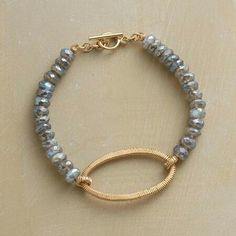 "Modern Keepsake Bracelet $450 > $348. Using an age-old wire-wrapping technique, Dana Kellin creates this deftly refined, keepsake-worthy labradorite bracelet. The design combines labradorite's shimmering elegance with 14kt gold-filled wires. USA. 7-1/4""L."