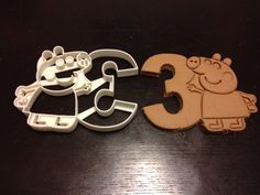 Peppa Pig Cookie Cutter holding the number 3. Great for your kid's third birthday party. Celebrate their 3rd year with custom cookies!