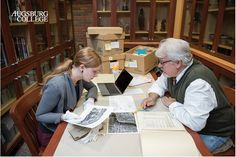 Professor Phil Adamo works with students to (re)tell Augsburg's history.
