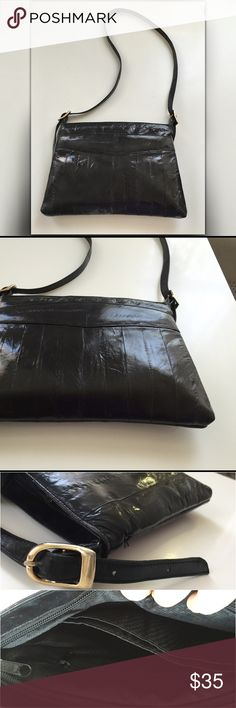 Vintage black eel skin purse Simply Amazing. Vintage yet like new! M.J. Made in Korea Black Eel Skin Purse Handbag. With adjustable shoulder strap could be worn as a crossbody. Perfect size. Large Front slip pocket for easy access. Both zippers work great!! Vintage Bags Shoulder Bags
