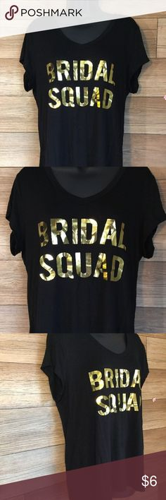 """Bridal Squad Black With Gold Print T-Shirt Size L Good condition-only worn once. No rips, tears or stains.   Approx. Measurements:   Size: Large  Under arm to under arm (chest): 20""""  Collar to hem (length): 24"""" Shoulder to Shoulder: 16""""   Sleeves (starting at shoulder): 5""""  Please note this is a USED item, so please check photos thoroughly, as they are part of description. Love Peace Lounge Tops Tees - Short Sleeve"""