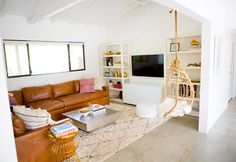 OK, so this couch with boho accents is a must and a hanging chair is meant to be in your bomb house…just saying