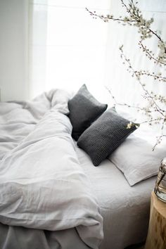 Simple stone gray linen bedding. Need this before winter hits. #MinimalistBedroom