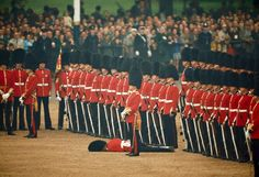 Irish guards remain at attention  after one of the guardsmen fainted, London, June 1966 - National Geographic