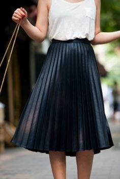 I can't say enough good things about pleated skirts. They have a retro vibe that is trendy and carefree. Plus the skirt does all the talking, you can just grab your favorite white tee and simple gold jewelry to put this outfit together.
