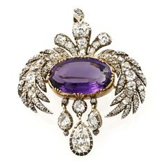 Georgian amethyst and diamond brooch, the central yellow gold-set oval-shaped faceted amethyst estimated to weigh 10 carats, surmounted by old brilliant-cut diamond-set foliate motifs and pendant loop, suspending pear-shaped diamond drops, total estimated diamond weight 5 carats, all silver cut-down collet-set to a yellow gold mount, gross weight 13.8 grams, circa 1810