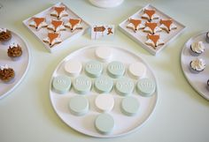 LETTUCE & CO - STYLE. EAT. PLAY run, run, as fast as you can gingerbread man themed children's birthday party. perfect colours for either a boy or girl! custom designed fox cookies, bow mini cupcakes and chocolate coated oreos. mint green tabletop. desert table styling.