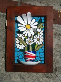 Daisies on a cabinet door by Nikki Inc Mosaics