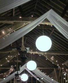 Barn wedding with drapery and lights. #wedding #weddinginvitations