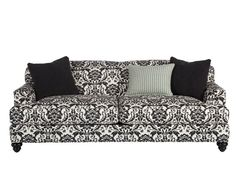 Our Anne sofa in a printed fabric fit for a queen.