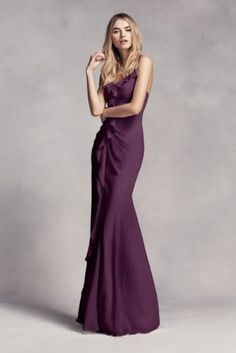Chiffon ruffles follow the midline of this long, glamorous bridesmaid dress with a sheer peekaboo hem in front.   White by Vera Wang, exclusively at David's Bridal  Polyester  Back zipper; fully lined  Dry clean  Imported (shown in Plum)
