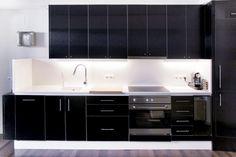 Love the sleek black cupboards