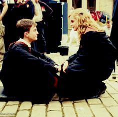 Daniel Radcliffe and Emma Watson on set