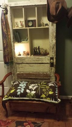 Halltree made from 100 yr. old door with antique arms/legs from chair. Added cubbies for knick knacks.