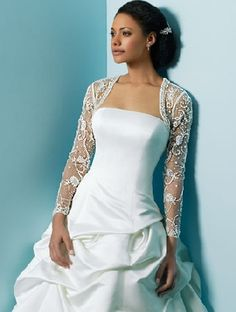 I love the elegant sleeves on this dress. Perfect for a formal wedding.