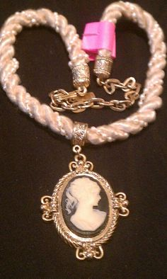 Medal Tag says 1928. Beaded Cameo Gold Tone Neckles