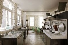 Loft kitchen, stainless steel + marble, by Paola Navone for Ciatti a Tavola, photo: Jean-Marc Palisse, via Côté Maison
