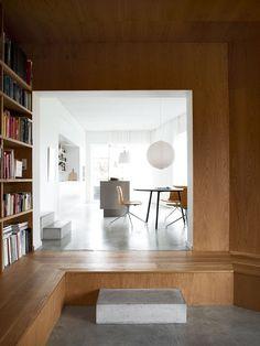 Villa Weinberg, Aarhus, Denmark, wood lined den, concrete sleepers as steps into kitchen, concrete floors, Noguchi Akari Pendant   Remodelista