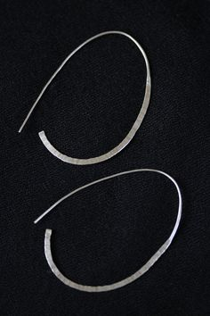 Handmade oval-loop shape earrings in hammered silver wire