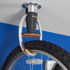 Store you bicycle on the ceiling. Just lift it up to bump the orange button to release. Do the same when clamp is open to lock it in place