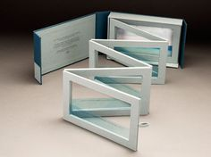 """Horizon by Susan Bonthron. In the spirit of Billy Collins' poem """"Horizon,"""" the book explores intersection of accordion & tunnel books w/ a set of 6 attached frames that produce different effects when folded into & extended out of the box. Each section suspends an acetate page that floats 2 lines of Collins' poem. The painting in the box's interior reflects the poem's final 2 lines: or standing on the ledge of a winter beach/watching light in the water, light in the air."""