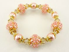 Beaded Bead Vintage Style Designer Stretch Bracelet With Colorado Topaz Crystals Rose Peach Crystals And Peach Glass Pearls Handmade Jewelry by LauraLandrumJewelry on Etsy https://www.etsy.com/listing/180906843/beaded-bead-vintage-style-designer