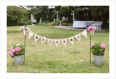 """Vintage inspired """"Welcome"""" sign to garden reception"""