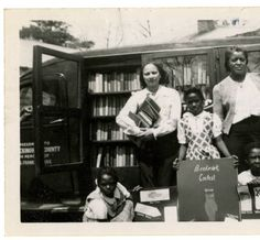 Bookmark contest winner, Geroline Graves (center), and others pose in front of bookmobile :: Library History Collection