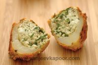 Aloo Nazakat: Deep-fried potato shells marinated and stuffed with cottage cheese mixture and baked.