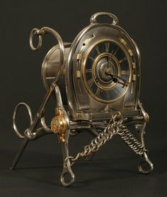 French Cavalry Regimental Clock (c. 1880)  A French timepiece, the case formed from the riding bits of a retiring cavalry officer's horse. Nickle and gilt.