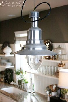 This little light in our kitchen is a favorite due to its great industrial style and its low price tag.The Ottava pendant lamp from IKEA. I sort of want to wire in two more for a set of three over the kitchen table. A clear Edison bulb looks great in it.