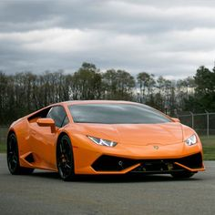 Lamborghini Huracan painted in Arancio Borealis   Photo taken by: @Lpv12 on Instagram (He is also the owner of the car)