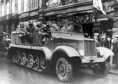German troops in an armoured vehicle in one of Prague's main streets following the annexation of Sudetenland, 1939. (Photo by Keystone)