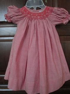 Red smocked baby gingham dress.