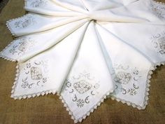 This set of 12 antique dinner napkins are made of pure white Irish Linen with beautiful Italian filet lace, cutwork, and whitework embroidery. They