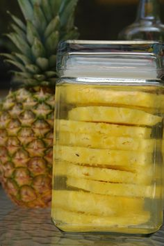 Pineapple Infused Vodka - Cut one whole fresh pineapple.  Toss the scraps.  Put pineapple into an air tight container, then pour 1/5 or liter of plain vodka.  Put in the fridge and let infuse for 5-7 days.  Then enjoy on the rocks.