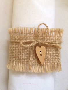 Burlap Hessian Wedding Table Napkin Rings with Twine Bow and Wooden Hearts by PapillonCreationsCo on Etsy https://www.etsy.com/uk/listing/476675709/burlap-hessian-wedding-table-napkin
