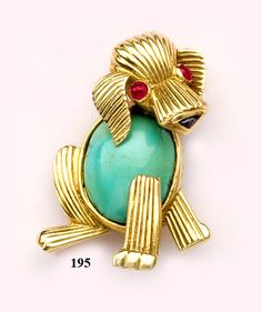 Turquoise, cabochon-cut ruby and gold shaggy dog brooch.Mauboussin, Paris