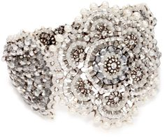 Miguel Ases Pyrite Bead Grand Flower Magnetic Bracelet. Handcrafted. Store in the provided suede pouch in a dry place. Miguel Ases provides its customers with a lifetime repair guarantee at no additional cost. Made in United States.