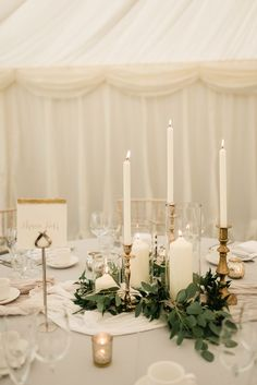 Elegant Grey, Green, White & Gold Black Tie, Marquee Wedding at Tullyveery House N. Ireland with Decor & Styling by Mood Events Gold Candle Sticks & Taper Candles Wedding Decor Candles Wedding, Gold Candles, Gold Wedding Decorations, Taper Candles, Candle Wedding Centerpieces, Round Table Centerpieces, Eucalyptus Centerpiece, Greenery Centerpiece, Unity Candle