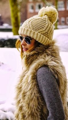 fur vest, I think I want one, but maybe I'll just wear my cat instead, she coats my clothing in fur as it is.....