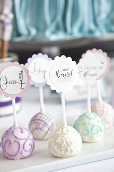 Pastel cake pops, guests' names as place settings.