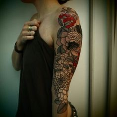 If I were ever going to get a sleeve, it would be something like this. I'm thinking of doing something similar to this as a cover up on my stomach/hip area. So gorgeous and I love the colors.