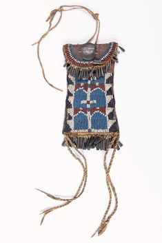 NATIVE AMERICAN POUCH - Kiowa Strike-a-Light Bag of buckskin with glass beads front and back, tin cone fringe, twisted cords and hammer