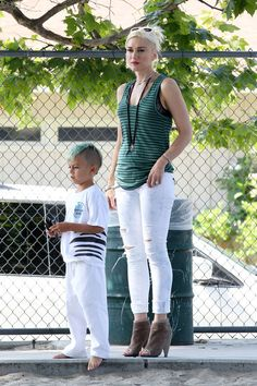 White ripped jeans, green striped vest top, and high heels... but still not your average soccer mum.  Also, I love that her top matches her son's hair. :)