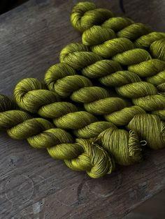 Self striping sock yarn witchy 400yd fingering weight green purple black glows
